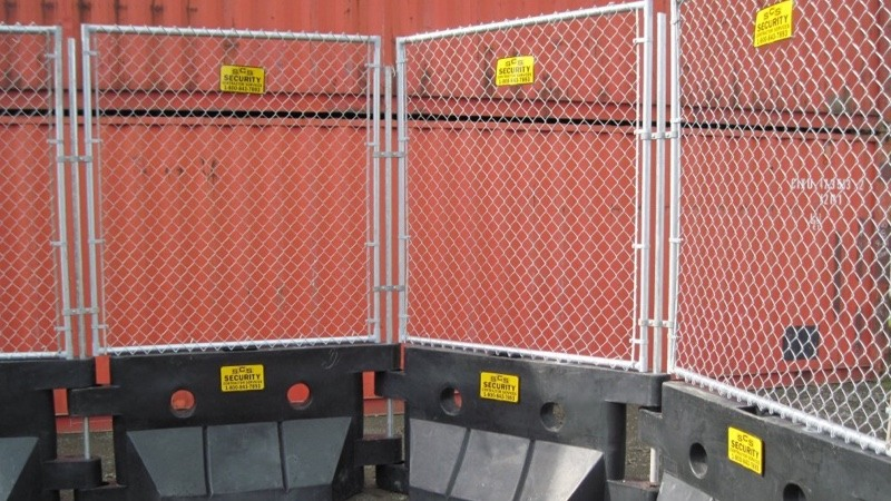 Watercade fencing in front of container