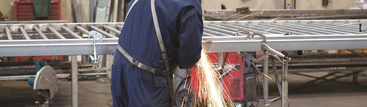 Man welding steel for fencing